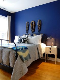 20 Bold & Beautiful Blue Wall Paint Colors Benjamin Moore Stunning in the master bedroom of Brian & Brad's Artfully Modern Apartment.