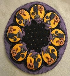 """This little pair of mischief makers are all ready to sweeten up your Halloween table! Create this """"Oh so cute"""" 12"""" table mat using wool or wool felt. This pattern is a real Halloween """"treat""""!  Finished Size: 12"""" Skill Level: Advanced Beginner. Penny Rug Patterns, Felt Patterns, Sewing Patterns, Boo Halloween, Halloween Table, Halloween Crafts, Holiday Crafts, Halloween Ideas, Halloween Sewing"""