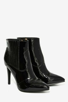 The Jessie Bootie is made in black patent vegan leather and features a pointed toe