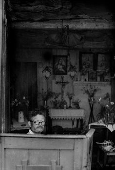 Henri Cartier-Bresson PORTUGAL. Beira Alta. Lamego. 1955. Man repairing shoes in his house.