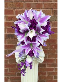 """Dimension: DIA 10"""" x 20"""" Long Classic Cascade silk floweråÊarrangement. Made of open roses in shades of purple,lavender,and white. Tiger lily and real touch calla lilies. åÊ"""
