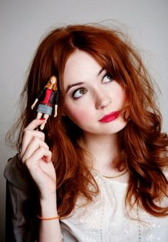 Karen Gillan with a toy Amy Pond