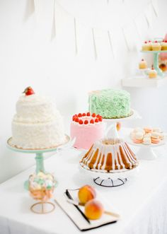 Easter dessert table | sugarandcloth.com featuring lovely Minted Cake Plates.