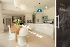 1950's inspired light and bright Manly beach house with Verner Panton chairs, George Nelson & Kartell Fly Suspension maps shades designed by Ferruccio Laviani