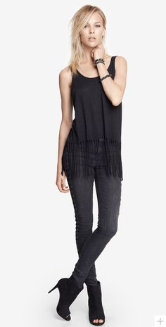 These lace up high waist jeans look so good when paired with a little fringe. #expressjeans