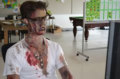 Working zombie. (He's a bit perplexed. What do you expect? His brain is mush.)
