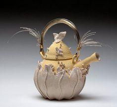 """""""Sprung,"""" with sterling silver and brass wire handle, by Eileen Braun."""