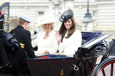 Kate Middleton Photos - Kate, Duchess of Cambridge waves to spectators as she shares a carriage with Prince Harry and Camilla, the Duchess of Cornwall, for the Trooping the Colour.  William, the Duke of Cambridge, took part in the parade for the first time while his new wife, Kate watched. - Trooping the Color for the Queen 7