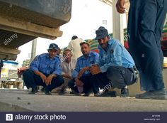 Download this stock image: Members of the Iraqi Border Police squat down and look at the camera at a crossing point between Iraq and Iran 2005 - AF1FP6 from Alamy's library of millions of high resolution stock photos, illustrations and vectors.