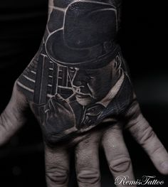 black and grey portrait hand tattoo by Remis, remistattoo, realism, realistic tattoo, tattoo ideas, inspiration