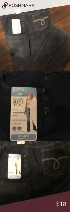 Lee Riders Mid - Rise Bootcut Jeans size 26 W Instantly slims you . Regular hip & thigh . Boot cut. Slender stretch denim . Flatters your figure . Comfort No gap waistband . These are stamped irregular. But are in great shape.waist measures 24 inches across . Mid rise is 13 inches . Inseam is 34 inches . Lee Jeans Boot Cut
