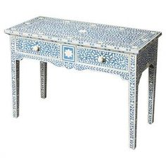 """Bring an ornate touch to your entryway or master suite with this handcrafted console table, showcasing a bone-inlaid botanical motif and curving apron.  Product: Console tableConstruction Material: Bone, select solid woods and engineered woodColor: Blue and whiteFeatures:  Curving apronTwo drawersHand-carved bone inlayDimensions: 30"""" H x 40.25"""" W x 17.75"""" DCleaning and Care: Wipe with a soft slightly dampened clothAssembly: No assembly required"""