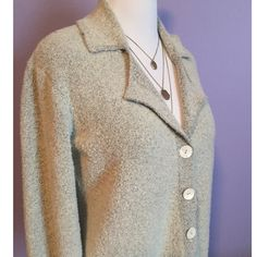 "Bouchée button cardigan Classic bouchée button cardigan in excellent condition. Perfect with a skirt, dress or slacks. 25"" from shoulder to hem. Color is beige with hints of black. 58% acrylic, 19% polyester, 13% wool, 8% nylon and 2% spandex. Machine wash. This is a women's plus size from Elisabeth store 2 petite, which would be equivalent to 2x Elisabeth Sweaters Cardigans"