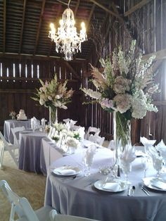 head table at the barn at hidden acres grey and pink centerpieces barn wedding