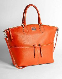 We love this satchel and it's in our favorite color! #Orange