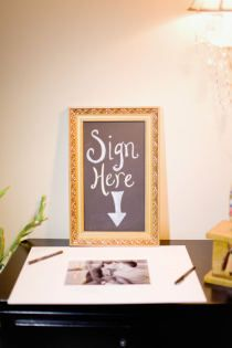 guest book - guests sign a matted photo of the bride & groom