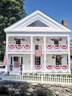 American flags and banners adorn the front of this Federal-era house, which underwent extensive renovation.
