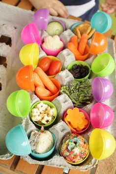 """Sneaky Easter Lunch - repurpose those plastic Easter eggs and create a """"sneaky way to eat your veggies"""" buffet."""