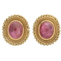 """Pink tourmaline and yellow gold earclips, each centering an oval cabochon pink tourmaline bezel-set in 18k yellow gold setting with a gold beading around the edges. Omega clip backs with posts. Each measuring 0.83"""" length and 0.70"""" width. 13.50 grams weight."""