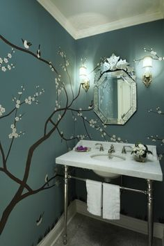 Graciela Rutkowski Interiors Beautiful Powder Room Design With Sakura Tree Wall Mural On Bold Blue Walls Paint Color Marble Washstand Polished Chrome