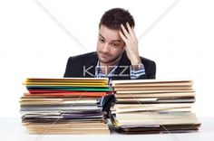 young businessman with hand in head looking at folders. - Young businessman with hand in head looking at folders over white background.