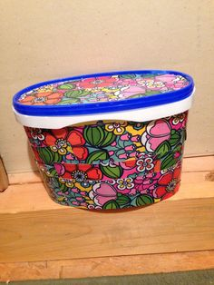 Altered Blue Bunny ice cream container with decorative duck tape.
