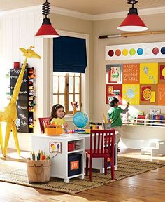 Art Playroom - love the big paint set on the wall.