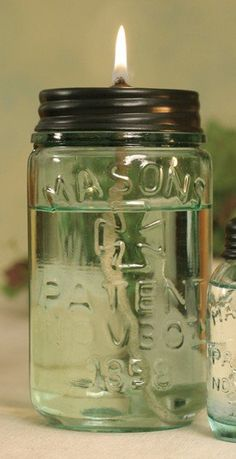 Mason jar oil lamp...canola oil and citronella oil-this is a great site devoted to mason jars!