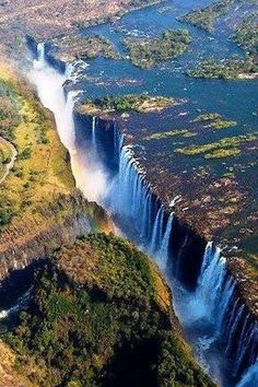 Victoria Falls is one of the Seven Natural Wonders of the World. Statistically speaking, it is the largest waterfall in the world. This recognition comes from combining the height and width together to create the largest single sheet of flowing water. Beautiful Waterfalls, Beautiful Landscapes, Places To Travel, Places To See, Places Around The World, Around The Worlds, Chutes Victoria, Landscape Photography, Nature Photography