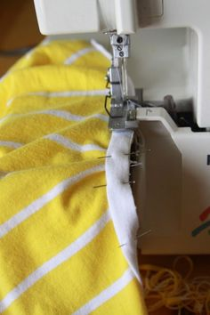 Learn how to turn an old, unworn mens or women's t-shirt into an adorable dress for a baby or toddler girl with this easy sewing tutorial. refashion/upcycle