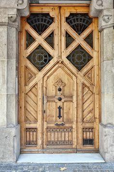 Door seen on an apartment building on Carrer de Mallorca near the Passeig de Gràcia in Barcelona, Catalunya.