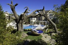 A fiberglass-and-steel oak tree is a sturdy support for a large swing. The tree was constructed in California, then shipped out to this backyard in Ohio. Rock Waterfall, Custom Pools, Mediterranean Home Decor, Tuscan Style, Oak Tree, Garden Beds, Hgtv, Curb Appeal, Outdoor Spaces