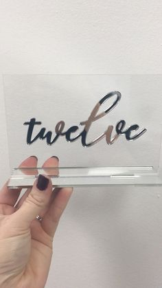 Silver and clear acrylic table number with laser cut mirror table number . Luxury table numbers from the Polka Dot Paper Shop Acrylic Table, Acrylic Mirror, Clear Acrylic, Laser Cutter Ideas, Laser Cutter Projects, Wedding Mirror, Wedding Shot, Mirror Video, Apple Watch Accessories