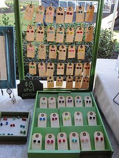 frame, twine, mini clothes pins, earrings on tags...link to a cool blog (Lazy Owl Boutique)