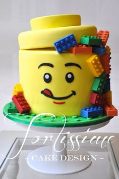 A LEGO Man Head Cake with Solid Chocolate Lego Blocks. Many other LEGO inspirational ideas for Birthday Parties. #birthdaycakes