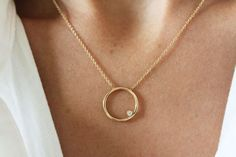 Visibly Interesting: The simplicity of a circle made all that more interesting with an off-center gem