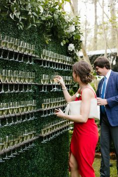 Champagne wall Living wall Boxwood wall Signature drink display Interactive cocktail hour Garden wedding inspiration North House Home and Garden New Orleans wedding NOLA. Wedding Goals, Our Wedding, Dream Wedding, Spring Wedding, Wedding Lounge, Wedding Reception Drinks, Wedding Dress Guest, Wedding Favors, Rustic Wedding