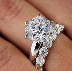 Simply beautiful...would love this with slightly smaller center stone