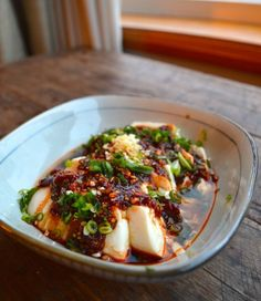 Cold spicy tofu or Liangban doufu is a great summer dish that is easy to make and delicious. Spicy bean sauce, sesame oil and raw scallions.garlic form the character of this dish