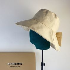 -Beige Bucket Hat. -100% Cotton. Cheap Burberry, Burberry Classic, Burberry Outlet Online, Bucket Hat, Bows, Beige, Cotton, Arches, Bob