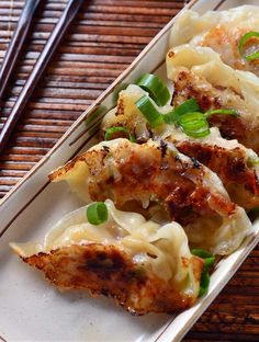 A spicy potsticker with chicken, jalapeno and sesame.
