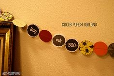 Use circle punch to string printables, cardstock, and Halloween scrapbook paper onto a super easy garland.