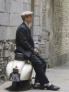 Brad Pitt with his Vespa. Angelina probably drives some vintage chopperized Harley right next to him or we should say in front of him.