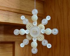 Things Needed for the Button Snowflake 3 or 4 wooden craft sticks (popsicle sticks) various white, silver, gold, or cream colored buttons, in various sizes craft glue of your choice - Crafting Tips Glue Crafts, Craft Stick Crafts, Christmas Projects, Holiday Crafts, Holiday Fun, Christmas Button Crafts, Craft Ideas, Button Crafts For Kids, Popsicle Stick Christmas Crafts