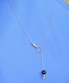 A simple tutorial on how to use fine chain to make a lariat necklace