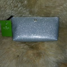 Kate Spade Cosmetic Bag Sassy sparkly silver cosmetic bag. One pocket on the inside. Lots of room. kate spade Bags Cosmetic Bags & Cases