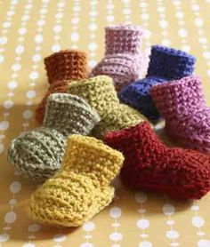 Ravelry: Easy Booties pattern by Lion Brand Yarn. Looove these little booties! Haven't got the pattern down yet, but it's really pretty simple. Definitely easy enough for a beginner crocheter!