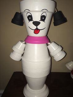 Hand painted and constructed Flower Pot Dog made from Terracotta pots. Head and body are made of 3 1/2 pots and arms are made of 1 pots. This