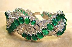 Harry Winston diamond and emerald bracelet, love the scale its HUGE!