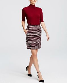 """Cast in a palette of high impact hues, this traffic stopping skirt wows with a bold graphic print and convenient side pockets. Exposed back zipper with snap closure. Lined. 20"""" long."""